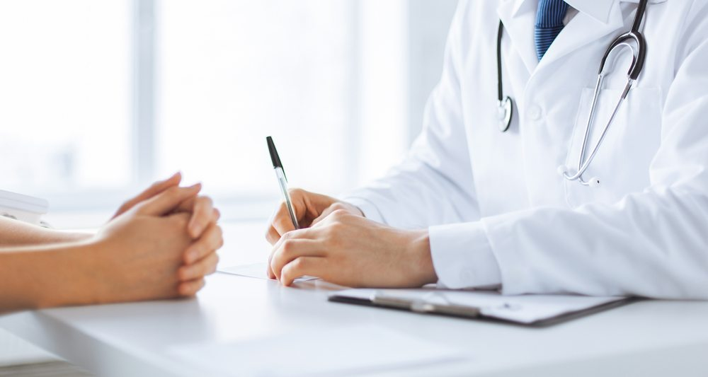 Patient talking about STD Testing in Houston with Doctor