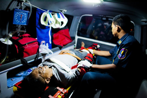 Photo of an EMT treating a victim in the back of
