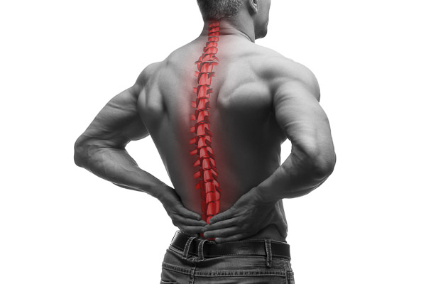 Photo of a man clutching his back with the spine lit up in red