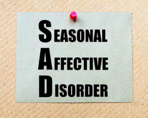 Seasonal Affective Disorder (SAD) Written On Paper Note