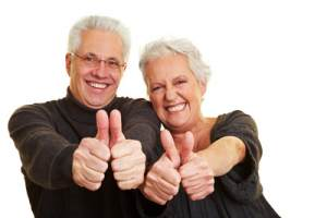 Regular exercise is good for healthy living - senior citizens doing a thumbs up
